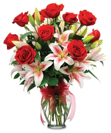 Impress your recipient with this dazzling bouquet of lilies and roses!